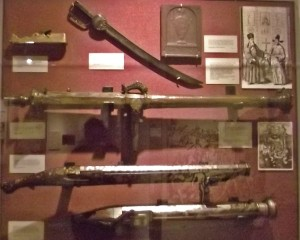 Ornate guns and weapons on display.