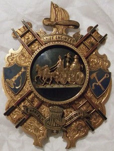 """Fire badge.  Inscribed """"To CHIEF ENGINEER, Thomas Kevill. As a tribute of esteem & respect from the officer's & members of the Norfolk Va FIRE DEPT., Dec 11th 1882""""."""