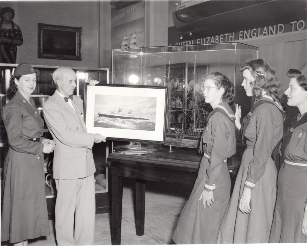 Director Frederick hill presents picture of SS United States to Sea Scouts, June 1954