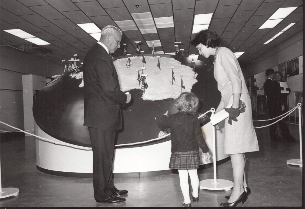 Dufek with woman and child in the International Antarctic Exhbition, Oct. 28, 1962