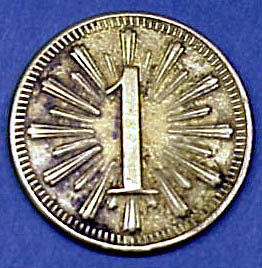 An oyster token from A.W. Murphy & Co.  These tokens were given to seafood workers for each gallon of oysters they shucked.  Their pay was based on the number of tokens collected. (2001.24.02)