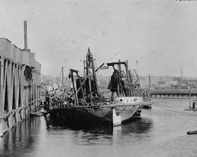 Stern view of burned hulk of General Slocum at pier