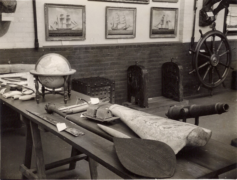 June 1934, objects on table in main room, scrimshaw display