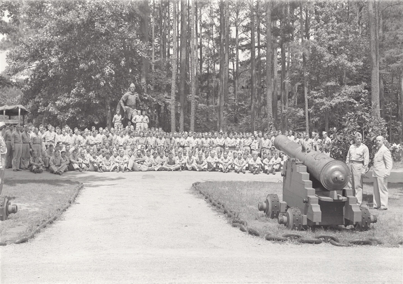Troops from Ft. Eustis, A battery 11th battalion, posed next to Leif Erikson statue