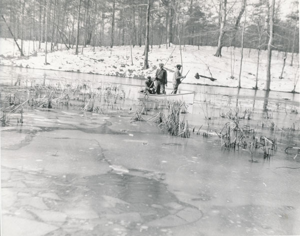 Breaking ice on Deer Park Lake, 12-20-1932