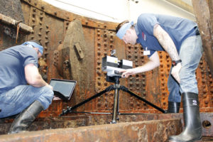 API technicians setting up to laser scan the turret's interior