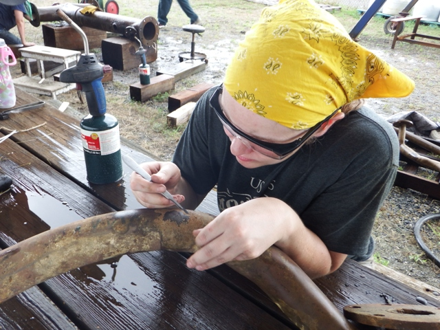 Kate removing some concretion mechanically.
