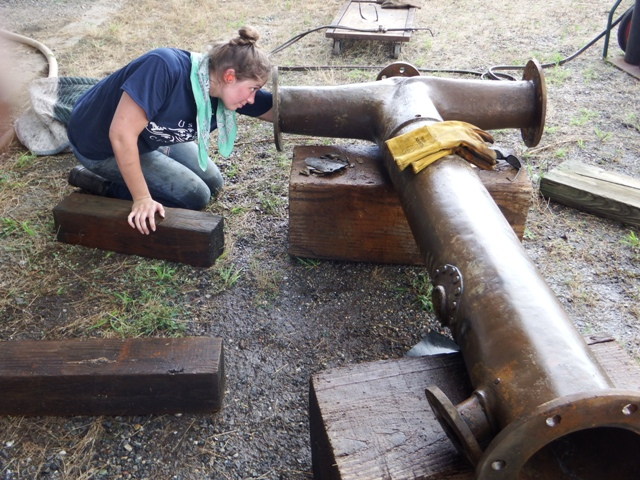 Lesley cleaning out the inside of one of the larger pipes.