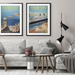 Vintage travel posters in pale Scandinavian-style living room