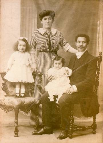 Image of Joseph Laroche sitting with his wife, Juliette and his two daughters, Simone and Louise