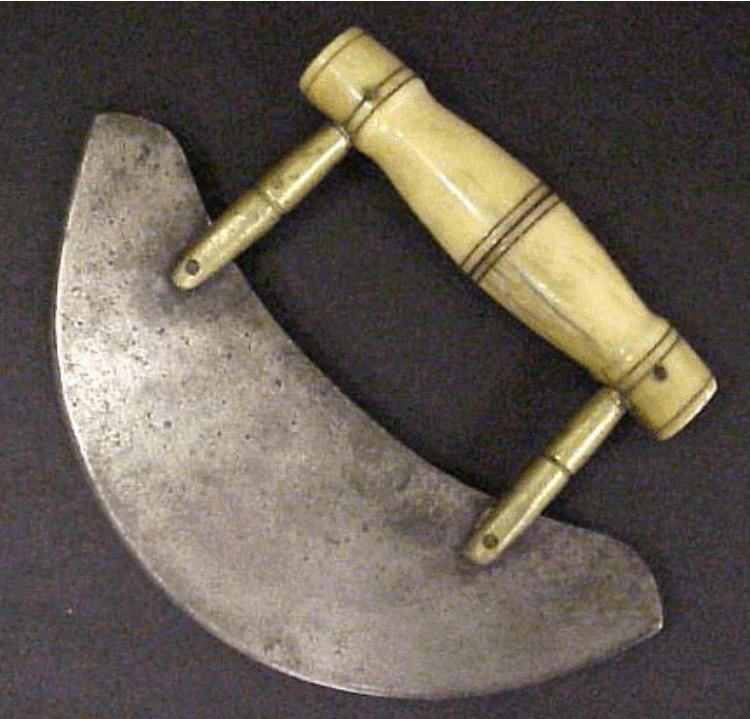 Image of semi-circular chopping knife called an ulu