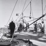 Deck scene showing cable line being prepared to lay on ocean floor.