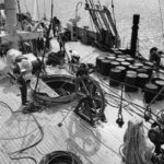Deck view of the crew and equipment for the transatlantic telephone cable.