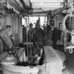 Crew working below deck with the submarine telephone cable.